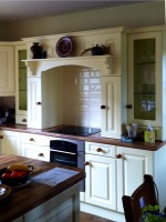 Cream hand-painted in frame kitchen showing hob and cooker unit - designed and fitted by Barrett Kitchens, County Donegal, Ireland