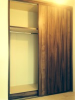 Fitted wood sliding wardrobe  - bedroom units designed and fitted by Barrett Kitchens, Donegal, Ireland