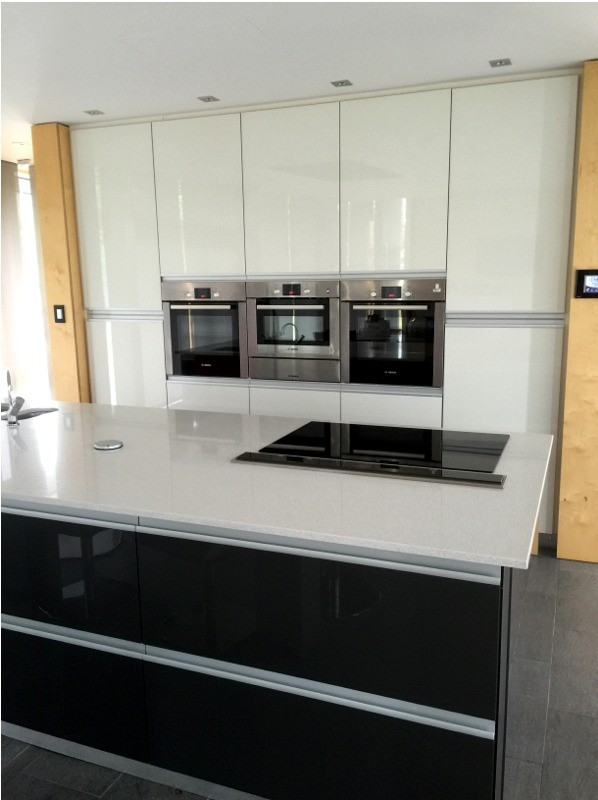 Gloss white modern kitchen with dark grey central unit - designed and fitted by Barret Kitchens, Letterkenny, Co. Donegal, Ireland