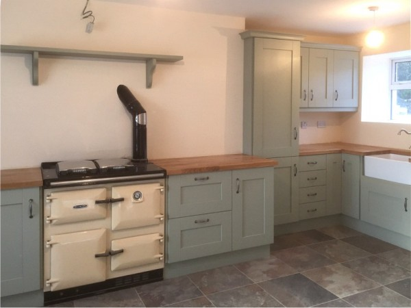 handpainted sage green kitchen with solid oak worktop designed and fitted by barrett kitchens