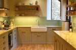 Green and cream hand-painted in frame kitchen with granite worktops -  designed and fitted by Barrett Kitchens, Letterkenny