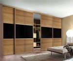 Large sliding wardrobe unit with wood doors - bedroom units designed and fitted by Barrett Kitchens, Donegal, Ireland