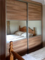 Wood Sliding robe with mirror - bedroom units designed and fitted by Barrett Kitchens, Donegal, Ireland
