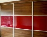 Sliding robe with mirror, red gloss and wood panels - bedroom units designed and fitted by Barrett Kitchens, Donegal, Ireland