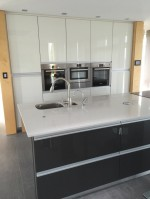 Kitchen during refurbishment to new gloss white units with black worktops - designed and fitted by Barret Kitchens, Letterkenny, Co. Donegal, Ireland