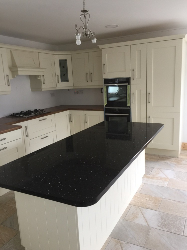 Albany Ivory painted kitchen with walnut  worktop on main kitchen and Quartz on island.