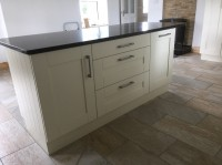 Albany Ivory painted kitchen with walnut worktop on main kitchen and Quartz on island